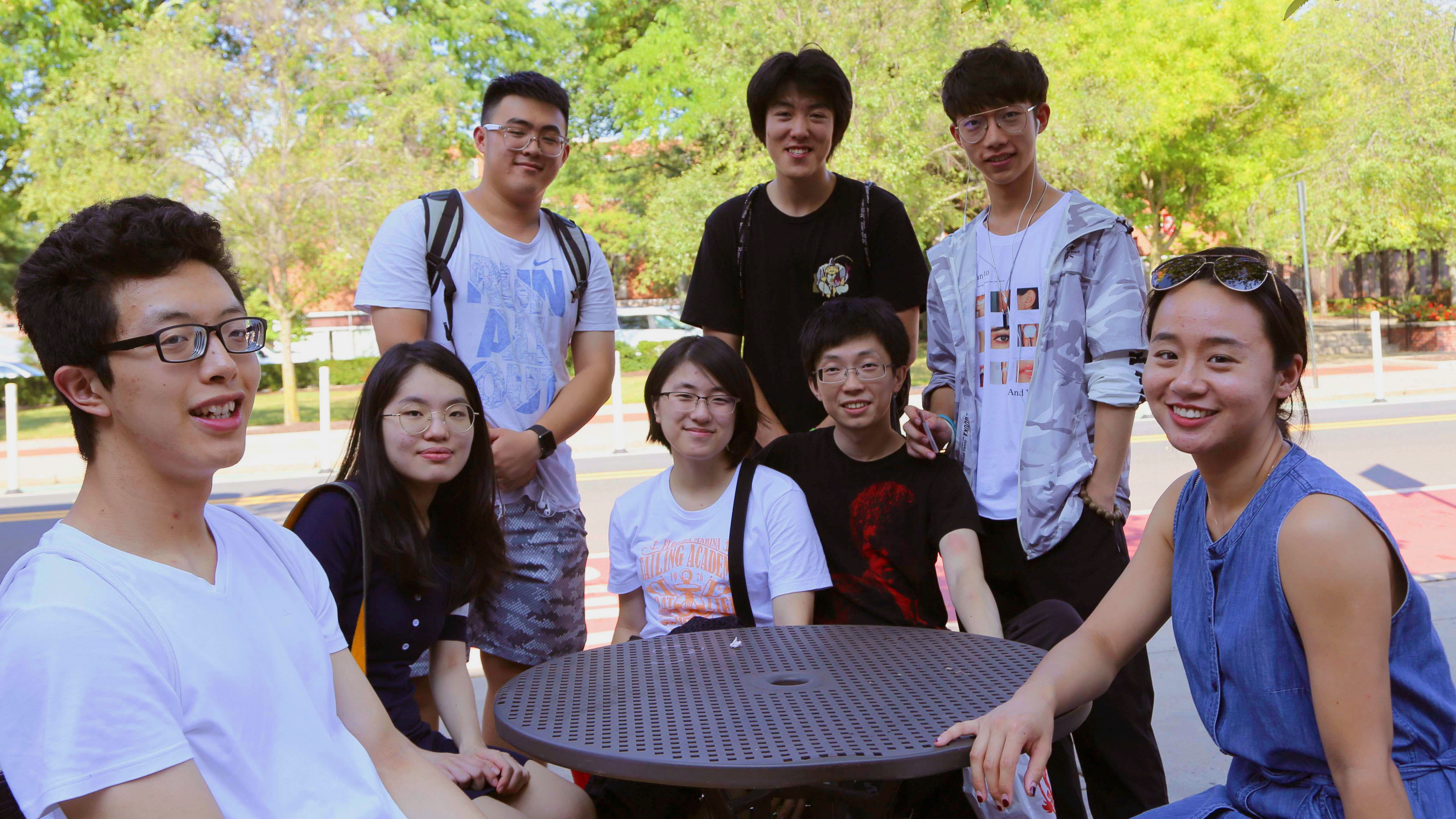 Students Around a Table Outside