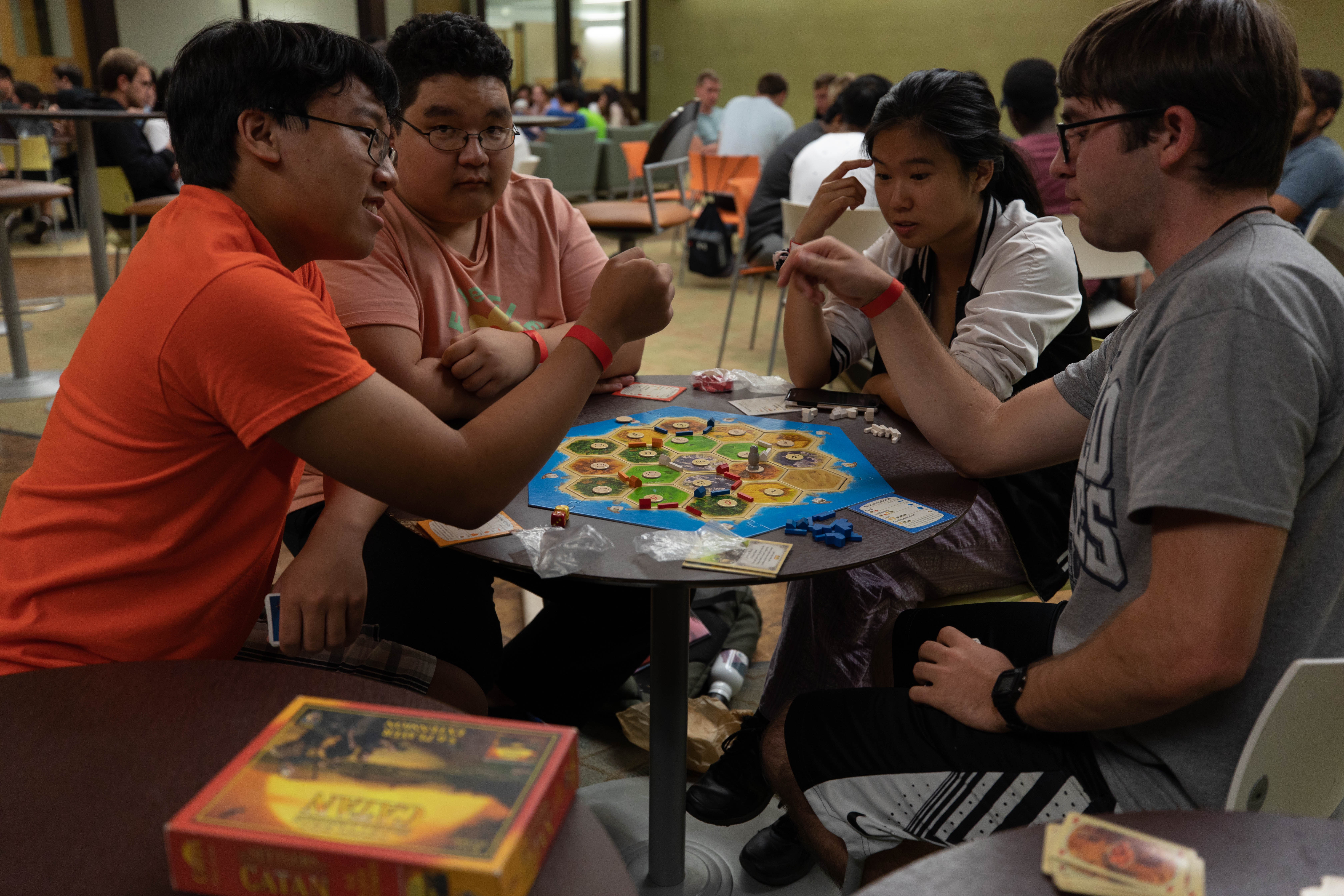 Group of students playing Catan
